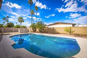 Jump into this pebble tec pool at 2414 W Pecos Ave Mesa AZ!