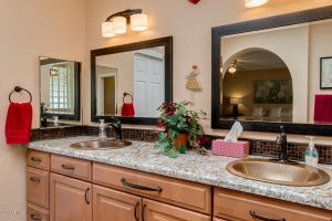 The master bath in this Palo Verde golf course home features double sinks.