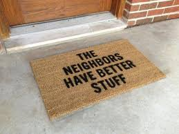 One of the top 10 holiday gifts for homeowners is a funny door mat.