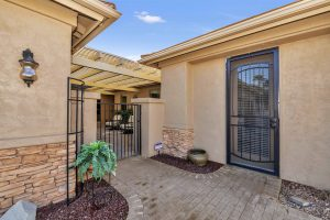 Welcome to the inviting courtyard at 24223 S Briar Wing Dr.