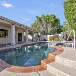 Take a dip in the pool and enjoy the backyard oasis.