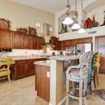 Enjoy cooking in the gourmet kitchen at 9105 E Rocky Lake Dr.